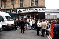 Fans Watch From Outside The Shop